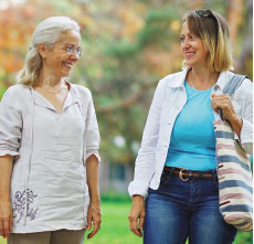 communicating with seniors image of two people walking and talking