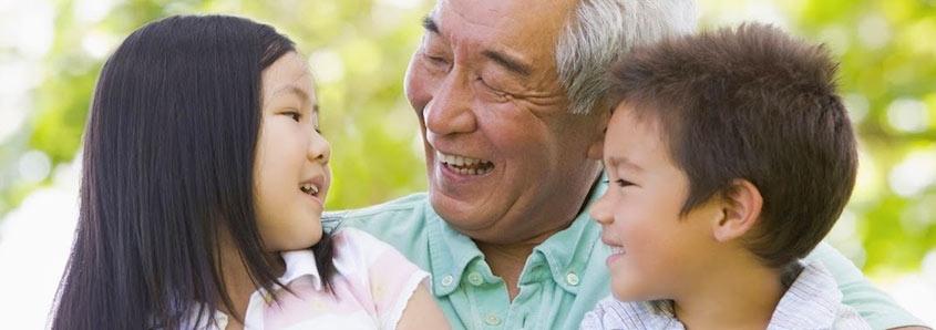 Elderly man and young children