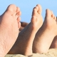 Rows of bare feet