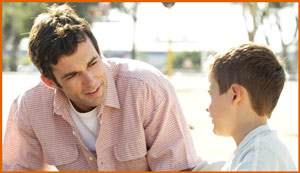 Father talking with young son