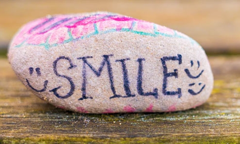 Painted rock with SMILE words