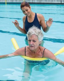 Helping senior with swimming